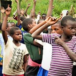 Displaced children's hands raised at Luhusha primary school/Masisi