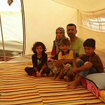 Mohammed, his wife and three children in the displacement camp of Amiriyat Al Fallujah, around 30 kms from Fallujah. Photo: NRC  In the words of Mohammed: ?We decided to leave three days a ...