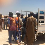 Despite the heat and the dust, people are overjoyed to have reached Al Fallujah camp in Ameriyat Al Fallujah. Warm greetings are exchanged between families who have fled, while ice is distri ...