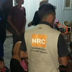 Newly arrived Iraqis from the outskirts of Fallujah on the night of 27-28 May 2016, being received by NRC staff. Photo: NRC