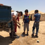 Children are filling up plastic bottle of water in Al Fallujah camp in Ameriyat Al Fallujah. They arrived this morning and have been given tents and some food. Water is scarce in the camps a ...