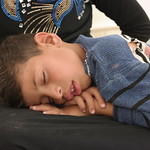 Aus (7) is sleeping on his mother's lap after a long and dangerous escape from the intense fighting in fallujah. Aus escaped the town with his three siblings, mother and father on Monday 23  ...