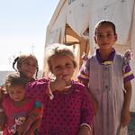 From the left : Afrah Khalil Ali (3), Saja Khalil Ali (6) (ponytalis), Nahla Khalil Ali (5), Rana Hasm Mater (6).  Displaced Iraqi girls standing at NRC?s School Support Centre entrance in ...