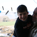 Abdul Wahab Taha, 48, and his son Hamza, 6, on the balcony of their house in Bekaa, Lebanon. Abdul Wahab is a Syrian refugee in Lebanon living in Bekaa with his wife and 5 children. Abdul Wa ...