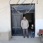 Abdul Wahab Taha, 48, and his son Hamza, 6, at the enterance of their house in Bekaa, Lebanon. Abdul Wahab is a Syrian refugee in Lebanon living in Bekaa with his wife and 5 children. Abdul  ...
